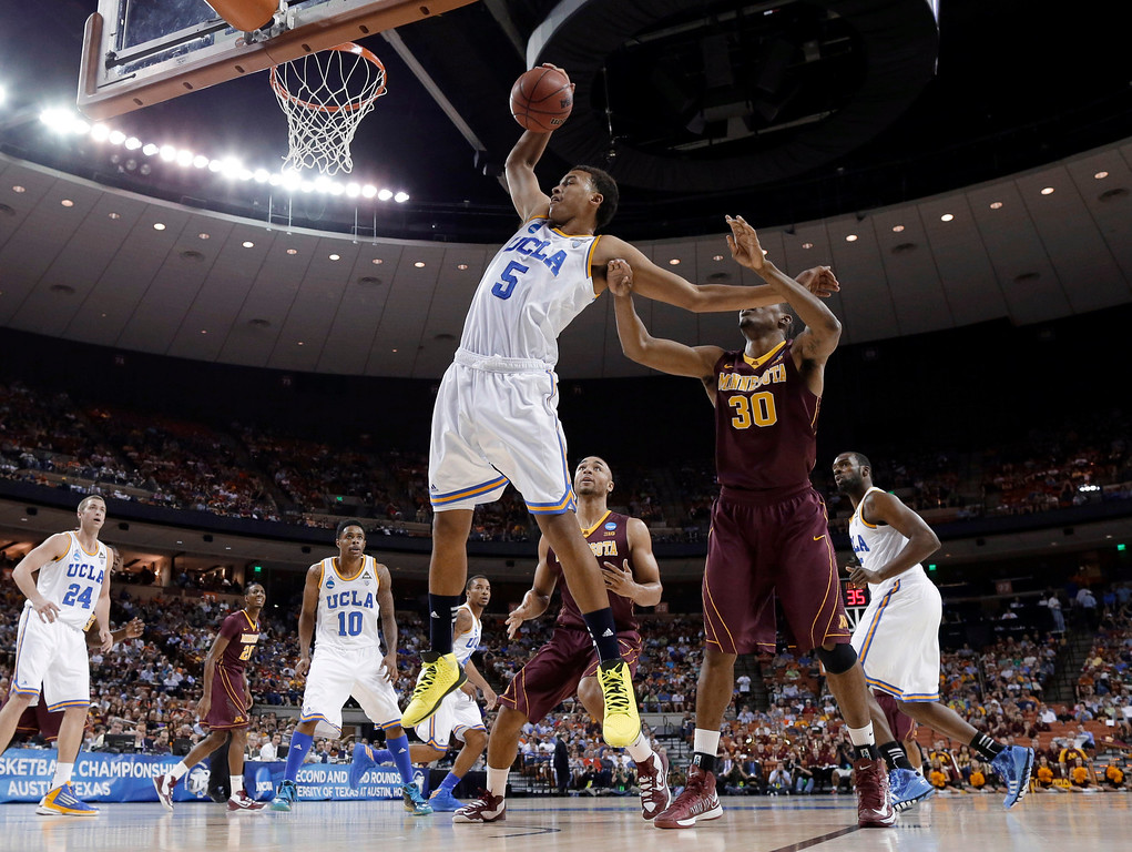 . UCLA\'s Kyle Anderson (5) grabs a rebound in front of Minnesota\'s Andre Ingram (30) during the first half of a second-round game of the NCAA men\'s college basketball tournament Friday, March 22, 2013, in Austin, Texas. (AP Photo/David J. Phillip)