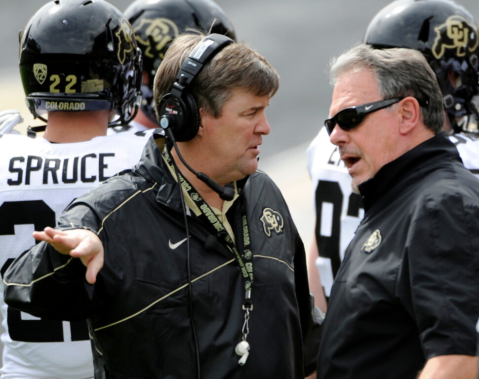 . BOULDER, CO.- APRIL13: New head coach Mike MacIntyre meets with defensive coordinator Kent Baer on the sidelines. The University of Colorado football team hosts its spring football game at Folsom Field under the direction of new head coach Mike MacIntyre. (Photo By Kathryn Scott Osler/The Denver Post)