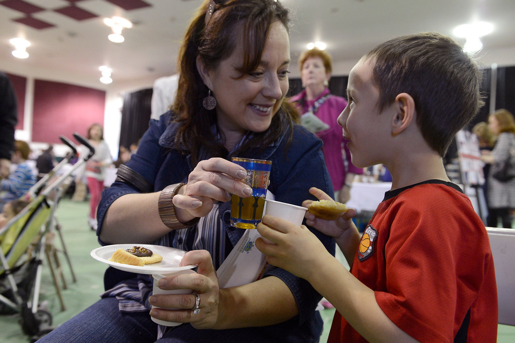 . DENVER, CO. - JANUARY 27: Tracy Lufkin 43-years-old toasts her son Matthew Lufkin 5-years-old as they drink tea from Morocco during the World Tea Fair at Denver Montclair International School January 27, 2013. There were 12 tables featuring tea samples from around the World.(Photo By John Leyba / The Denver Post)