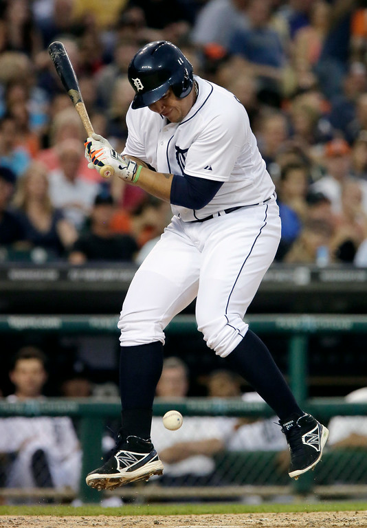 . iDetroit Tigers\' Miguel Cabrera reacts after being hit by a pitch from Seattle Mariners\' Felix Hernandez during the third inning of a baseball game Saturday, Aug. 16, 2014, in Detroit. (AP Photo/Duane Burleson)