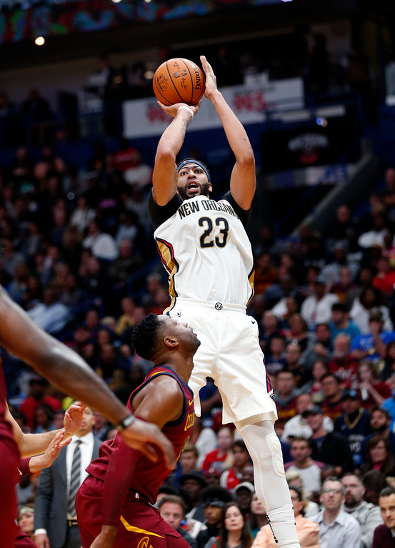 . New Orleans Pelicans forward Anthony Davis (23) shoots over Cleveland Cavaliers guard Dwyane Wade in the second half of an NBA basketball game in New Orleans, Saturday, Oct. 28, 2017. The Pelicans won 123-101. (AP Photo/Gerald Herbert)