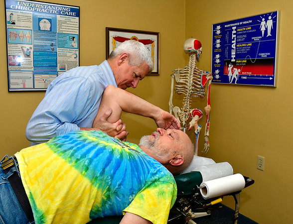 11/20/2019 Mike Orazzi | StaffrBristol Chiropractor Dr. Glen Palmisano works with patient Jerry Stowel.