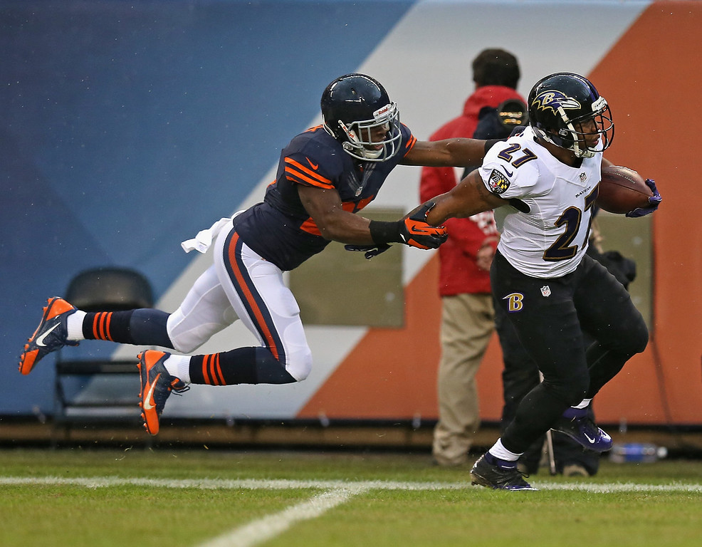 . Major Wright #21 of the Chicago Bears forces Ray Rice #27 of the Baltimore Ravens out of bounds on a long gain at Soldier Field on November 17, 2013 in Chicago, Illinois. (Photo by Jonathan Daniel/Getty Images)