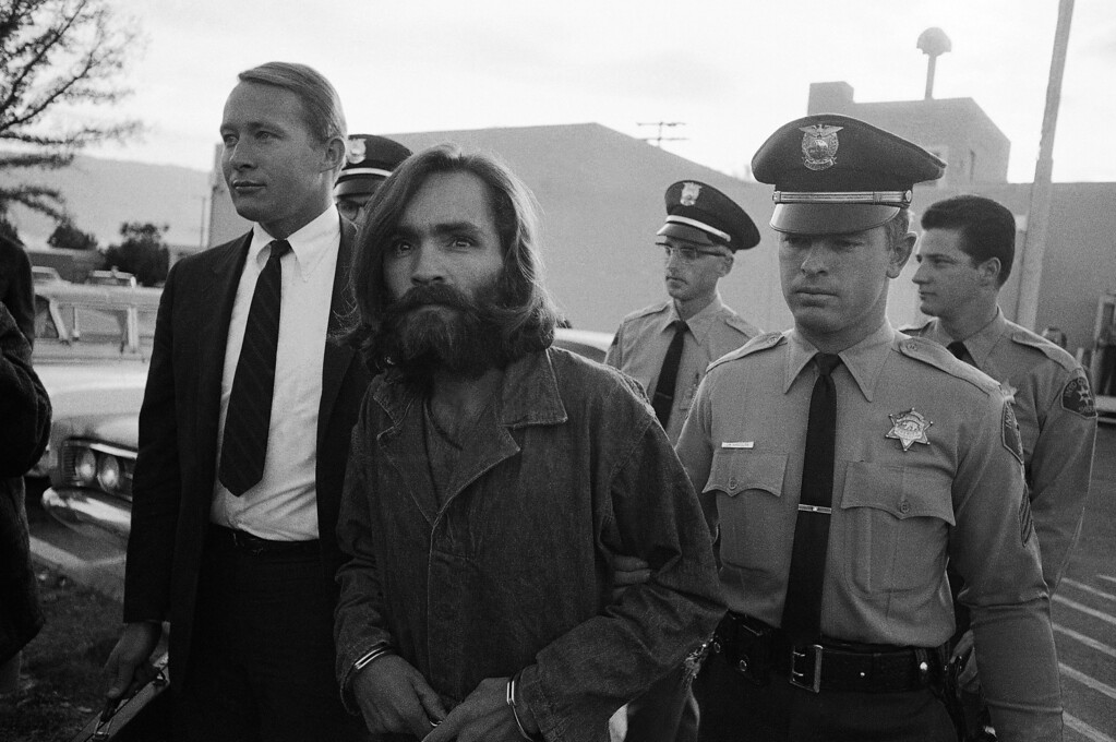". Charles M. Manson, leader of a hippie cult accused of multiple murders, leaves a Los Angeles courtroom, Dec. 22, 1969 after telling a judge ""lies have been told\"" about him. His followers say the 35-year-old ex-convict has hypnotic powers. (AP Photo/Wally Fong)"