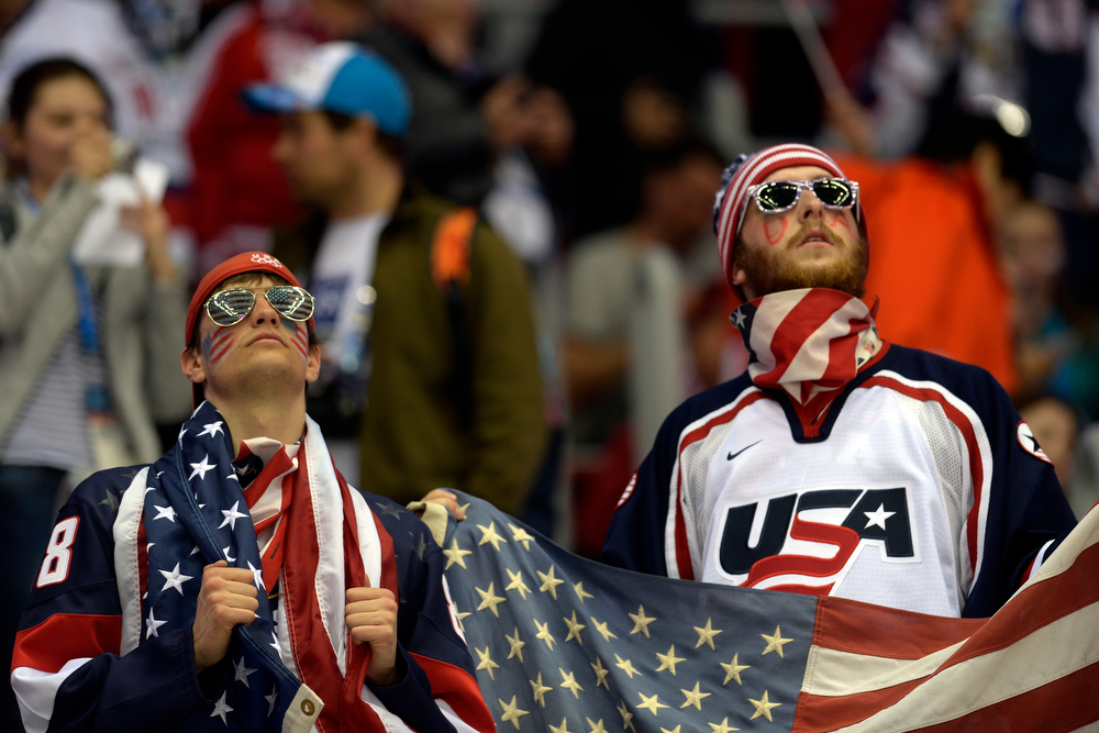 . U.S.A. fans watch the action during the first period of men\'s hockey action at Bolshoy arena. Sochi 2014 Winter Olympics on Saturday, February 15, 2014. (Photo by AAron Ontiveroz/The Denver Post)