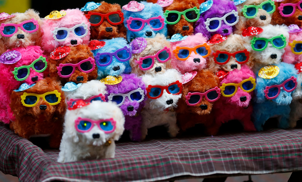 . Colorful stuffed toy puppies are sold in Manila\'s Chinatown district as Filipinos celebrate the Chinese Lunar New Year Friday, Feb. 16, 2018 in Manila, Philippines. This year is the Year of the Dog in the Chinese Lunar calendar. (AP Photo/Bullit Marquez)