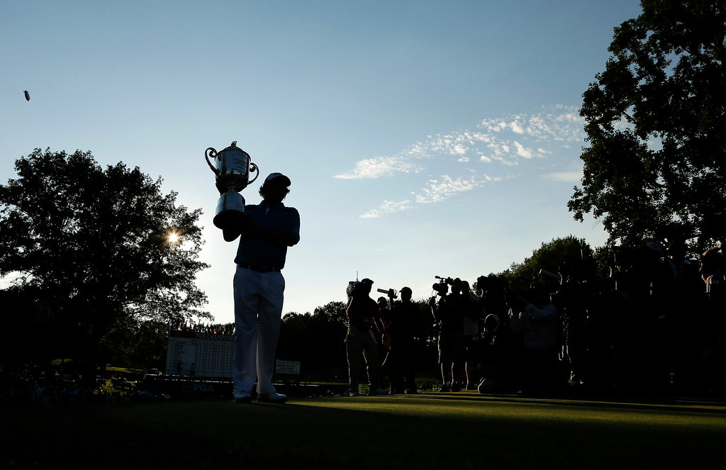 . Jason Dufner holds up the Wanamaker Trophy after winning the PGA Championship golf tournament at Oak Hill Country Club, Sunday, Aug. 11, 2013, in Pittsford, N.Y. (AP Photo/Charlie Riedel)