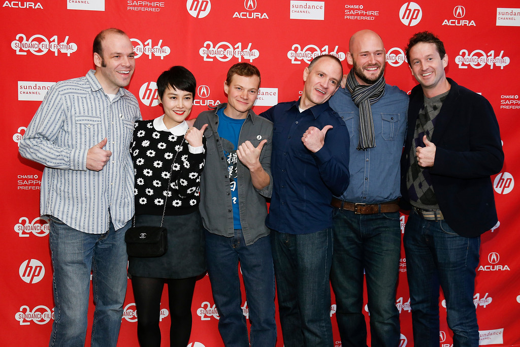 """. From left, writer and producer Nathan Zellner, cast member Rinko Kikuchi, director of photography Sean Porter, director David Zellner, producer Chris Ohlson and Director of Programming for the Sundance Film Festival Trevor Groth pose together at the premiere of the film \""""Kumiko, the Treasure Hunter,\"""" during the 2014 Sundance Film Festival, on Monday, Jan. 20, 2014, in Park City, Utah. (Photo by Danny Moloshok/Invision/AP)"""