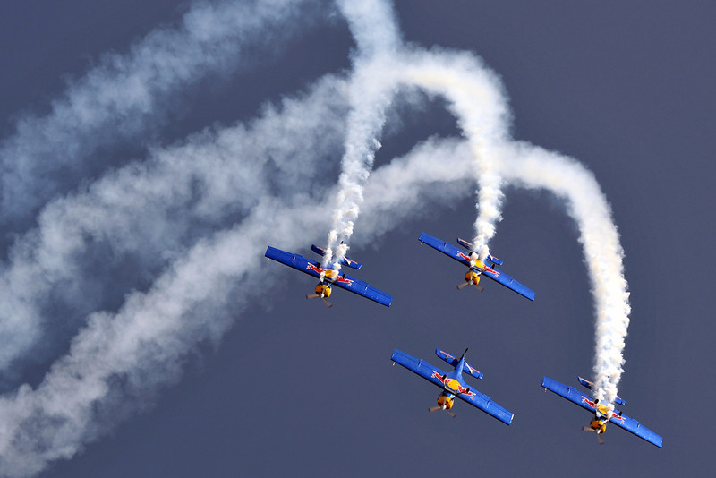 . Members of The Flying Bulls aerobatics team from the Czech Republic fly in formation in their Zlin Z-50 aircraft during Aero India 2013 at the Yelahanka Air Force station in Bangalore on February 6, 2013. India, the world\'s leading importer of weaponry, opened one of Asia\'s biggest aviation trade shows Wednesday with Western suppliers eyeing lucrative deals and a Chinese delegation attending for the first time.  Manjunath Kiran/AFP/Getty Images