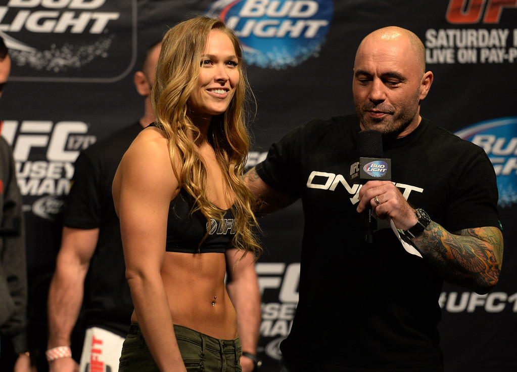 . Ronda Rousey talks with UFC color commentator Joe Rogan during her weigh in for UFC 170 at the Mandalay Bay Events Center in Las Vegas Friday, February 21, 2014. (Photo by Hans Gutknecht/Los Angeles Daily News)