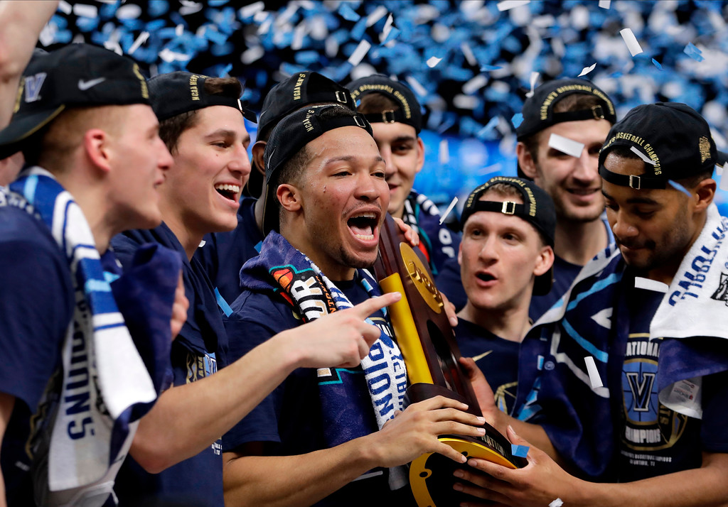 . Villanova guard Jalen Brunson, center, celebrates with teammates after beating Michigan 79-62 in the championship game of the Final Four NCAA college basketball tournament, Monday, April 2, 2018, in San Antonio. (AP Photo/Eric Gay)