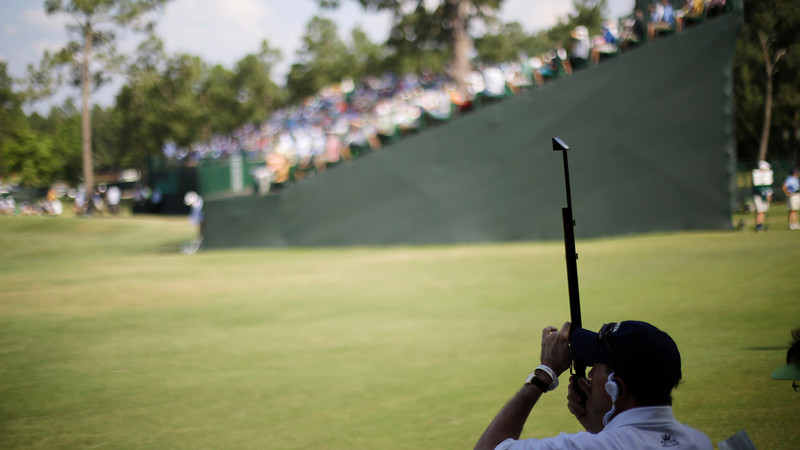 . A fan watches from the 12th fairway during the third round of the U.S. Open golf tournament in Pinehurst, N.C., Saturday, June 14, 2014. (AP Photo/David Goldman)