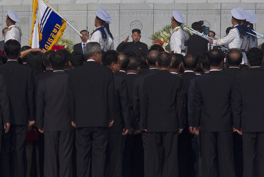 . North Korean leader Kim Jong Un, center, salutes during an opening ceremony for a cemetery for Korean War veterans on Thursday, July 25, 2013 in Pyongyang, North Korea marking the 60th anniversary of the signing of the armistice that ended hostilities on the Korean peninsula. (AP Photo/David Guttenfelder)