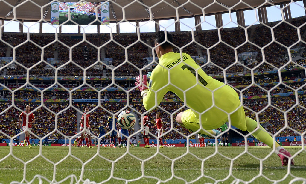 . Switzerland\'s goalkeeper Diego Benaglio makes a save during a Group E football match between Switzerland and Ecuador at the Mane Garrincha National Stadium in Brasilia during the 2014 FIFA World Cup on June 15, 2014. AFP PHOTO / ADRIAN DENNIS