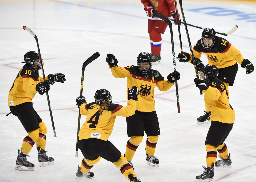 . Germany\'s Franziska Busch (C) celebrates with her teammates after scoring a goal during the Women\'s Ice Hockey Group B match between Russia and Germany at the Shayba Arena during the Sochi Winter Olympics on February 9, 2014. JONATHAN NACKSTRAND/AFP/Getty Images
