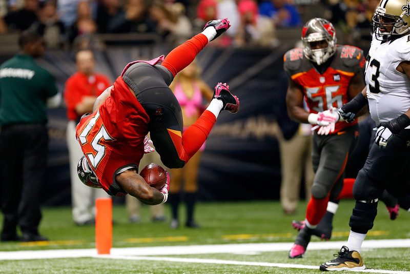 . Danny Lansanah #51 of the Tampa Bay Buccaneers dives into the endzone following an interception during the third quarter of a game against the New Orleans Saints at the Mercedes-Benz Superdome on October 5, 2014 in New Orleans, Louisiana.  (Photo by Wesley Hitt/Getty Images)