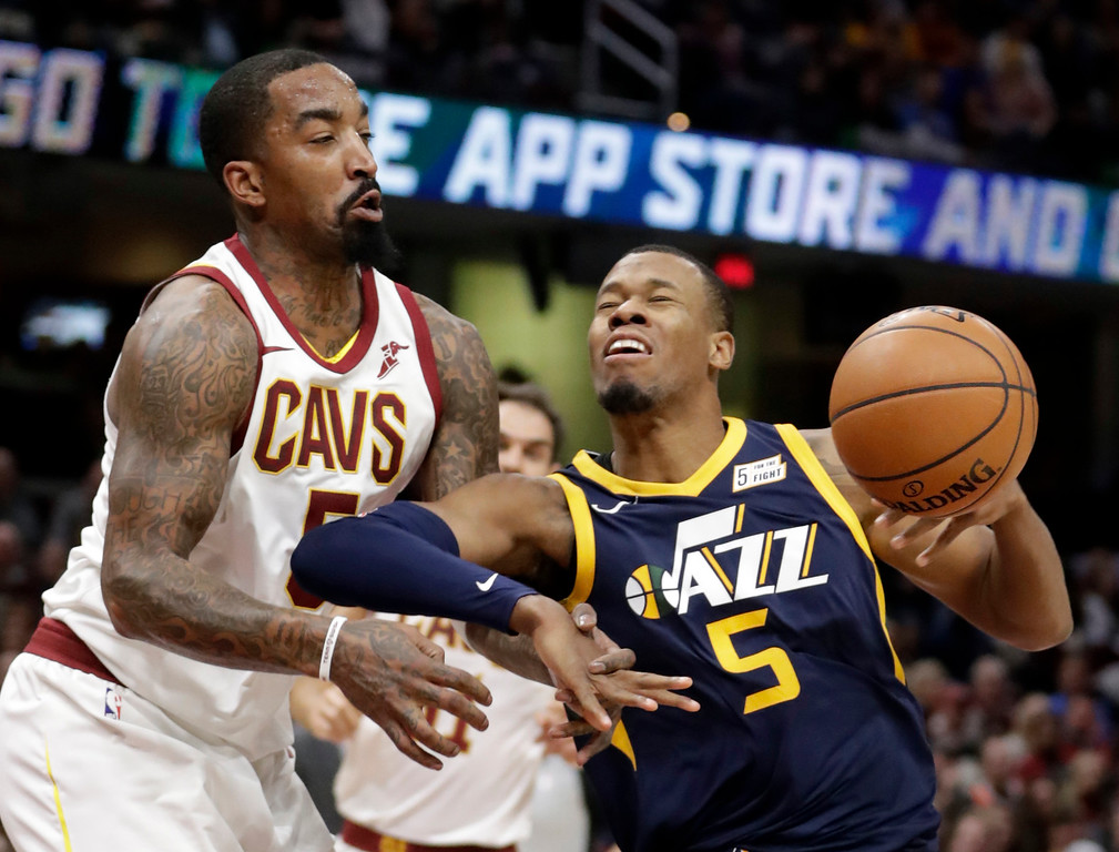 . Cleveland Cavaliers\' JR Smith, left, knocks the ball loose from Utah Jazz\'s Rodney Hood in the first half of an NBA basketball game, Saturday, Dec. 16, 2017, in Cleveland. (AP Photo/Tony Dejak)