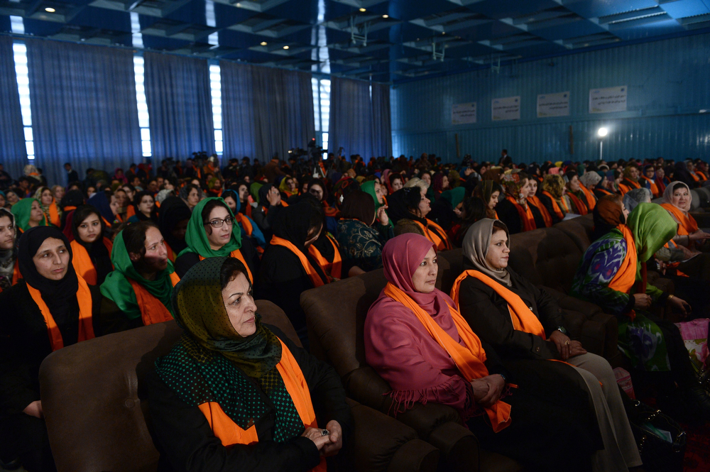 Description of . Afghan guests look on as unseen President Hamid Karzai speaks during an event to mark International Women's Day at the Amani High School in Kabul on March 8, 2014. International Women's Day (IWD), originally called International Working Women's Day, is a global day observed annually on March 8, celebrating the economic, political and social achievements of women past, present and future. (WAKIL KOHSAR/AFP/Getty Images)