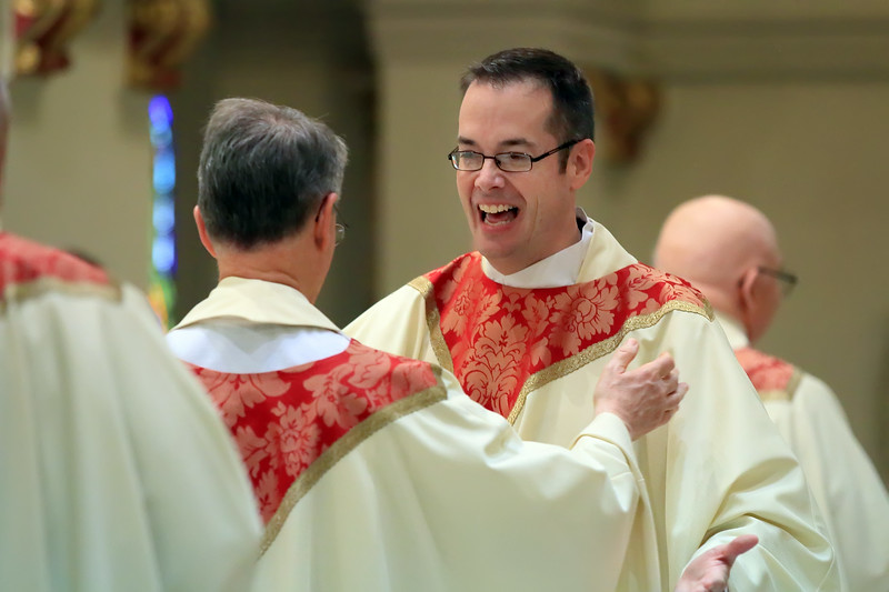 Richard Jasper exchanges a sign of peace from fellow Priests during his Ordination at Cathedral of Saint Peter Church, Saturday, May 20, 2017. wwwDonBlakePhotography.com