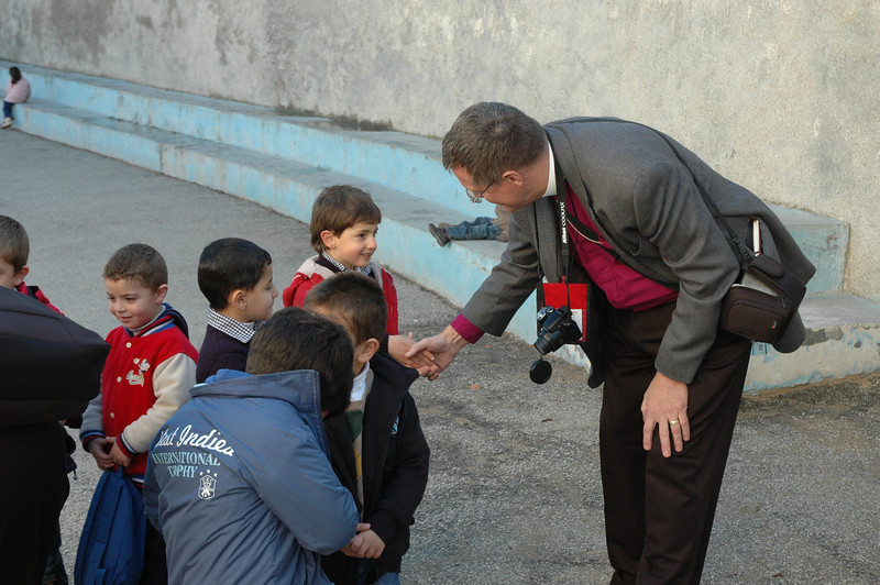Bishop Gerald Mansholt, ELCA Central States Synod, greets a student Jan. 12 at Evangelical Lutheran School of Hope, Ramallah.