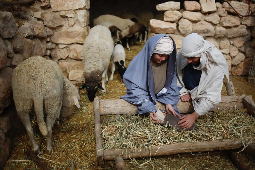 . Christian actors portray Joseph and Mary during a re-enactment of a Nativity scene of the birth of Jesus Christ during Christmas festivities at the Nazareth Village in Nazareth, northern Israel , Thursday, Dec. 21, 2017. (AP Photo/Ariel Schalit)