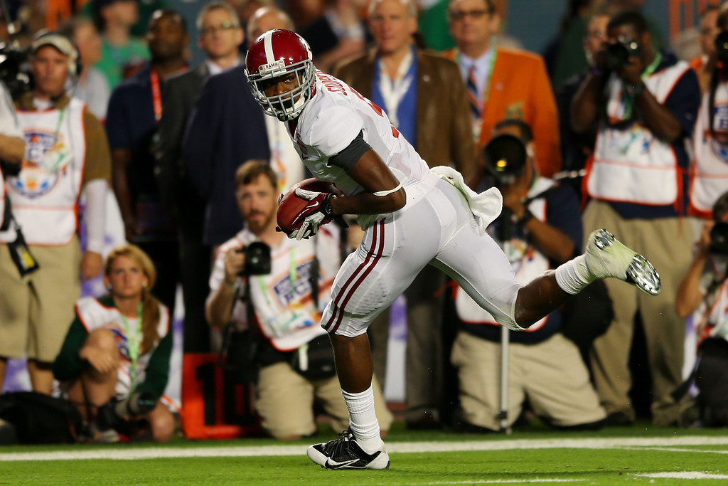 . MIAMI GARDENS, FL - JANUARY 07:  Amari Cooper #9 of the Alabama Crimson Tide runs with ball on his way to scoring a touchdown in the third quarter against the Notre Dame Fighting Irish during the 2013 Discover BCS National Championship game at Sun Life Stadium on January 7, 2013 in Miami Gardens, Florida.  (Photo by Mike Ehrmann/Getty Images)