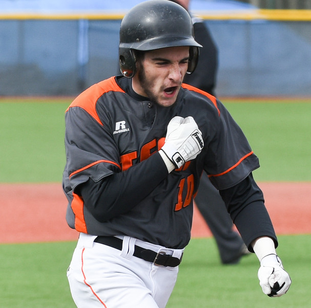 040717  Wesley Bunnell   Staff  New Britain High School baseball defeated E.C. Goodwin Tech in a game played at CCSU on Friday afternoon. Paul Prior (10) thumps his chest as he prepares to cross the plate.