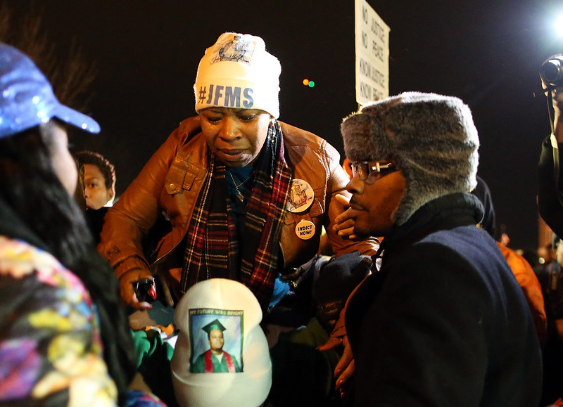 . Lesley McSpadden, mother of Michael Brown, is escorted away from in front of the Ferguson police department after a grand jury\'s decision was delivered on November 24, 2014 in Ferguson, Missouri. A St. Louis County grand jury has decided to not indict Ferguson police Officer Darren Wilson in the shooting of Michael Brown that sparked riots in Ferguson, Missouri in August.  (Photo by Justin Sullivan/Getty Images)