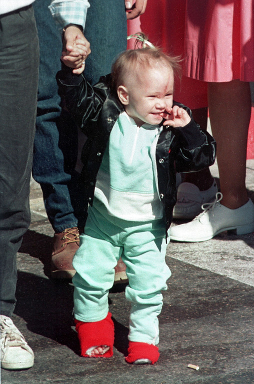 . 19-month-old Jessica McClure holds her mother\'s hand as they leave the Midland Memorial Hospital  in Midland, Texas, on November 20, 1987. The toddler spent more than a month in the hospital after she was rescued from the abandoned water well she was trapped in for 50 hours. (AP Photo)