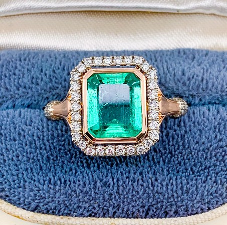 "The ""Camellia"" Halo - Featuring an Emerald Cut Emerald"