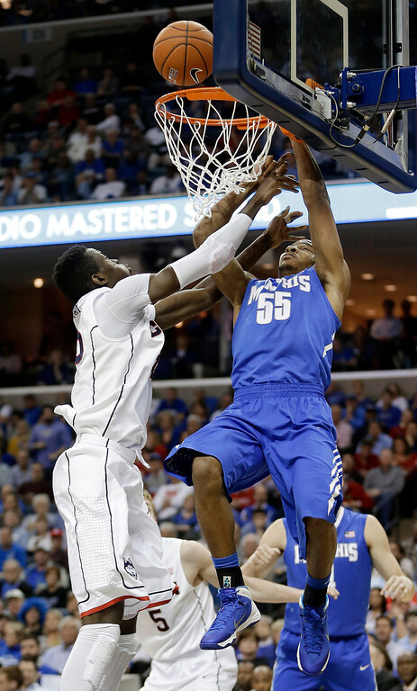 . Memphis guard Geron Johnson (55) misses a dunk as Connecticut center Amida Brimah, left, defends during the second half of an NCAA college basketball game in the quarterfinals of the American Athletic Conference men\'s tournament Thursday, March 13, 2014, in Memphis, Tenn. (AP Photo/Mark Humphrey)
