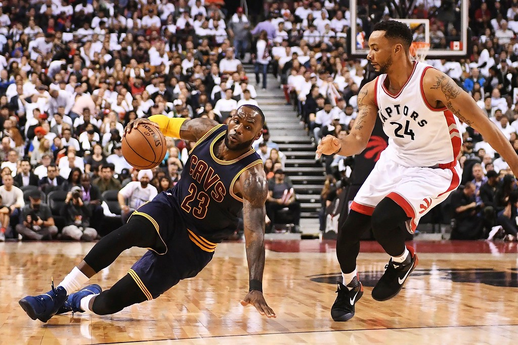 . Cleveland Cavaliers forward LeBron James (23) slips on the floor as Toronto Raptors guard Norman Powell (24) looks on during the second half of Game 3 of an NBA basketball second-round playoff series in Toronto on Friday, May 5, 2017. (Frank Gunn/The Canadian Press via AP)
