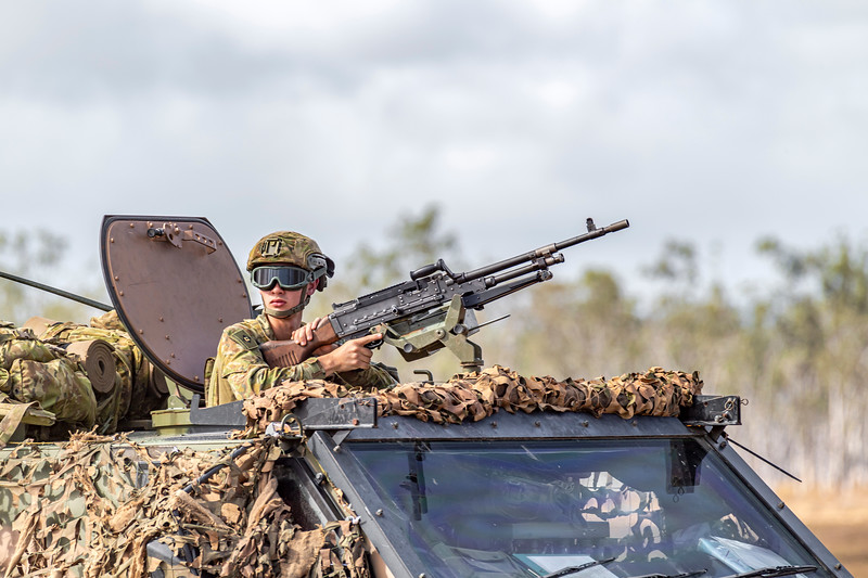 Exercise Talisman Saber 2019.  Soldier mans a light machine gun aboard a bushmaster during HiMARS live fire exercise.