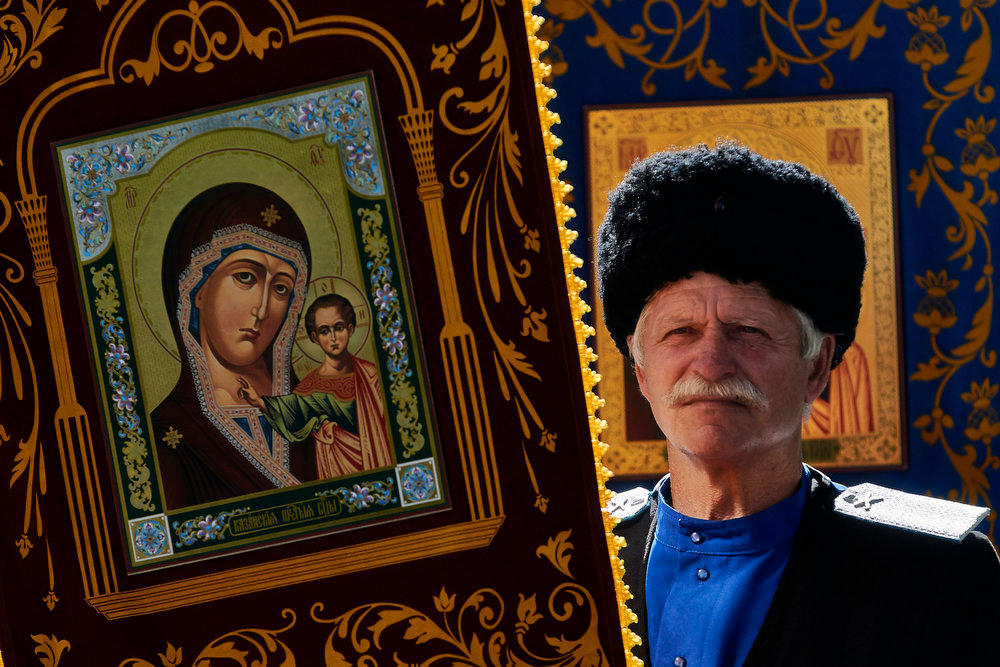 . A Russian Orthodox believer holds an icon as he celebrates Easter in the city of Stavropol on May 5, 2013. DANIL SEMYONOV/AFP/Getty Images