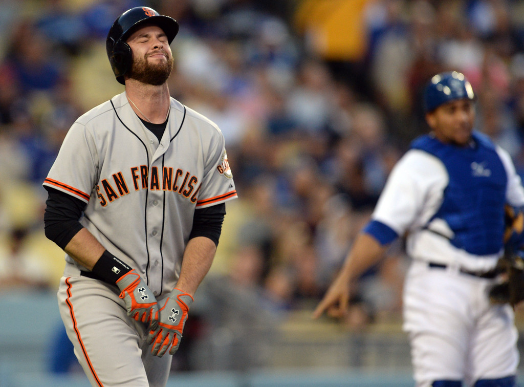 . The Giants Brandon Belt #9 grimaces after being hit in the hand by a pitch during their game against the Dodgers at Dodger Stadium Friday, May 9, 2014. (Photo by Hans Gutknecht/Los Angeles Daily News)