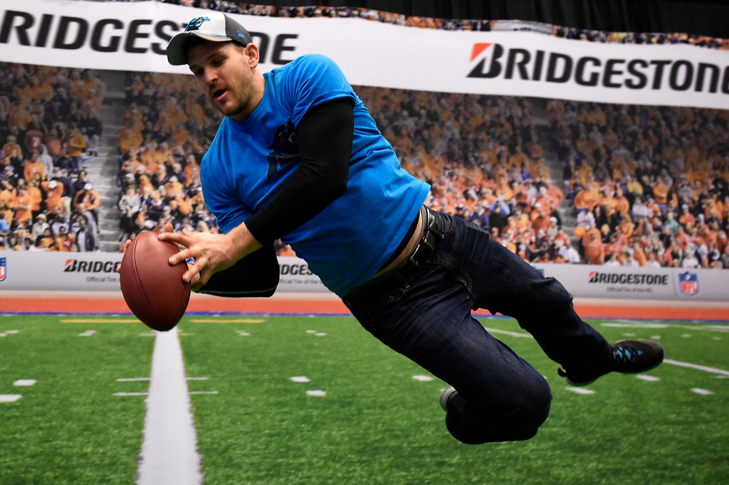 . SAN FRANCISCO, CA - FEBRUARY 05: Carolina Panther fan Fred Frey 29 of Charlotte, NC makes a catch at the NFL Experience in downtown San Francisco, CA. February 05, 2016 (Photo by Joe Amon/The Denver Post)