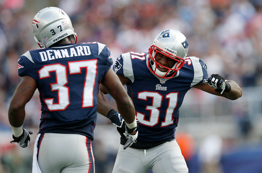 . New England Patriots cornerbacks Alfonzo Dennard (37) and Aqib Talib (31) celebrate an incomplete pass by the Tampa Bay Buccaneers in the second half of an NFL football game Sunday, Sept. 22, 2013, in Foxborough, Mass. The Patriots won 23-3.(AP Photo/Elise Amendola)