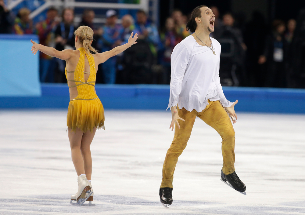 . Tatiana Volosozhar and Maxim Trankov of Russia react after their routine in the pairs free skate figure skating competition at the Iceberg Skating Palace during the 2014 Winter Olympics, Wednesday, Feb. 12, 2014, in Sochi, Russia. (AP Photo/Darron Cummings)