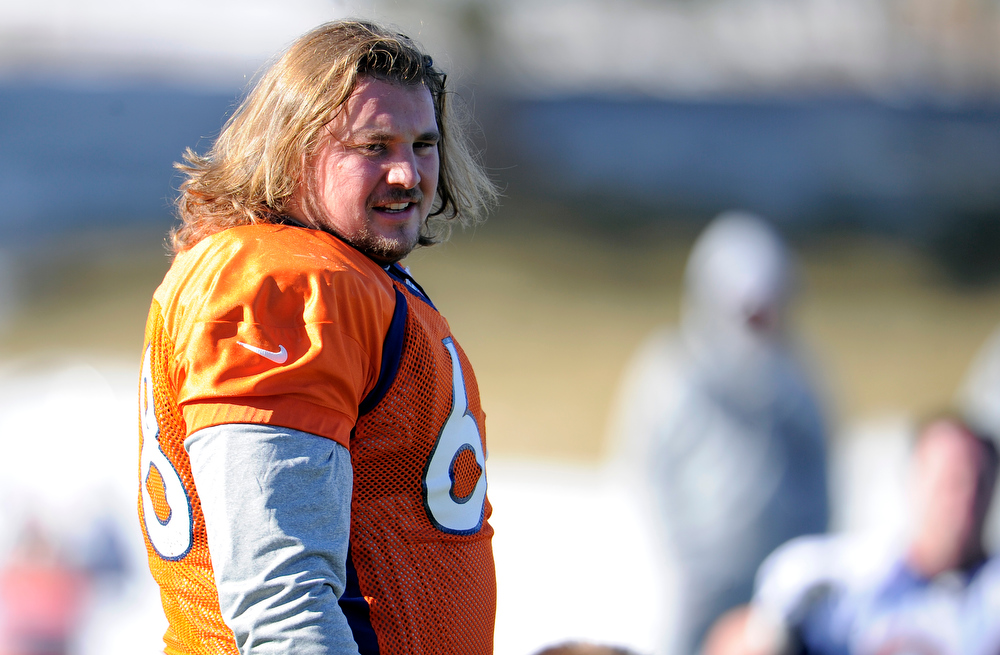 . Denver Broncos guard Zane Beadles (68) stretches during practice Thursday, December 20, 2012 at Dove Valley. The Broncos also selected Beadles as their Walter Payton NFL Man of the Year award recipient. This prestigious award historically recognizes a player for outstanding leadership both on the field and in the community John Leyba, The Denver Post