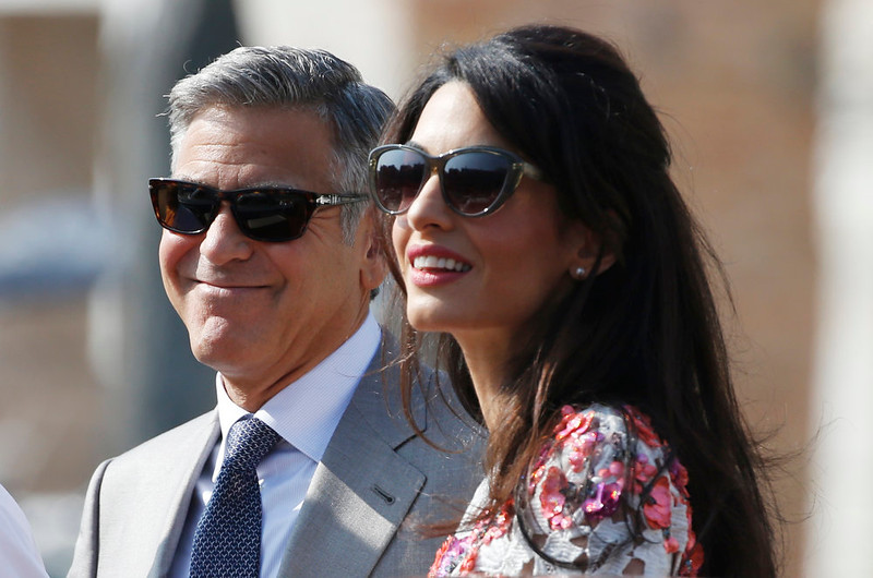 . George Clooney and his new wife Amal Alamuddin as they leave the Aman luxury Hotel in Venice, Italy, Sunday, Sept. 28, 2014. George Clooney married human rights lawyer Amal Alamuddin Saturday, the actor\'s representative said. (AP Photo/Luca Bruno)