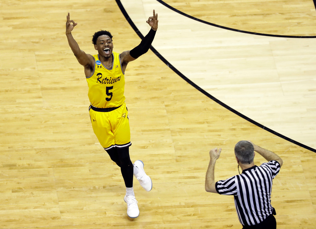 . UMBC\'s Jourdan Grant celebrates after a basket against Virginia during the second half of a first-round game in the NCAA men\'s college basketball tournament in Charlotte, N.C., Friday, March 16, 2018. (AP Photo/Chuck Burton)
