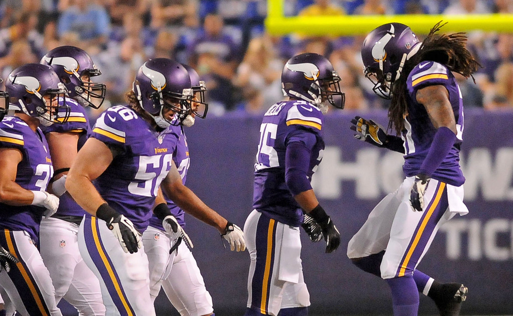 . Vikings cornerback Bobby Felder, right, celebrates with cornerback Marcus Sherels, middle, after Sherels intercepted a pass during the third quarter against the Titans.  (Pioneer Press: Sherri LaRose-Chiglo)