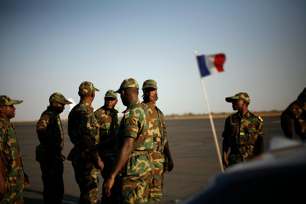 Description of . West African soldiers from Togo arrive at Bamako\'s airport Thursday Jan. 17, 2013. They were the first contingent of West African troops brought to Mali to help French and government forces  fight jihadist insurgents in control of the north of the country. Fighting raged in one Mali town, airstrikes hit another and army troops raced to protect a third, on the seventh day of the French-led military intervention to wrest back Mali\'s north from al Qaida-linked groups. (AP Photo/Jerome Delay)