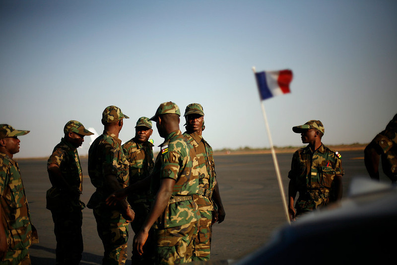 . West African soldiers from Togo arrive at Bamako\'s airport Thursday Jan. 17, 2013. They were the first contingent of West African troops brought to Mali to help French and government forces  fight jihadist insurgents in control of the north of the country. Fighting raged in one Mali town, airstrikes hit another and army troops raced to protect a third, on the seventh day of the French-led military intervention to wrest back Mali\'s north from al Qaida-linked groups. (AP Photo/Jerome Delay)