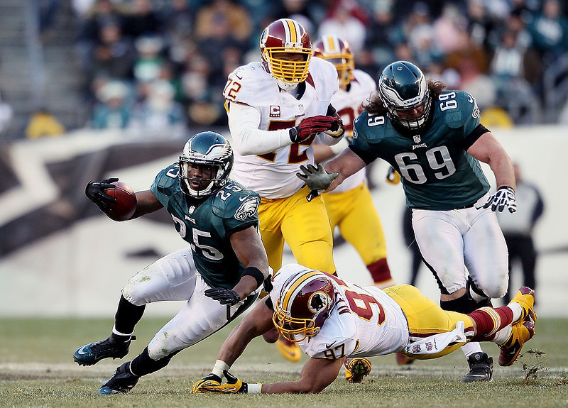 . Lorenzo Alexander #97 of the Washington Redskins tackles LeSean McCoy #25 of the Philadelphia Eagles at Lincoln Financial Field on December 23, 2012 in Philadelphia, Pennsylvania.  (Photo by Alex Trautwig/Getty Images)