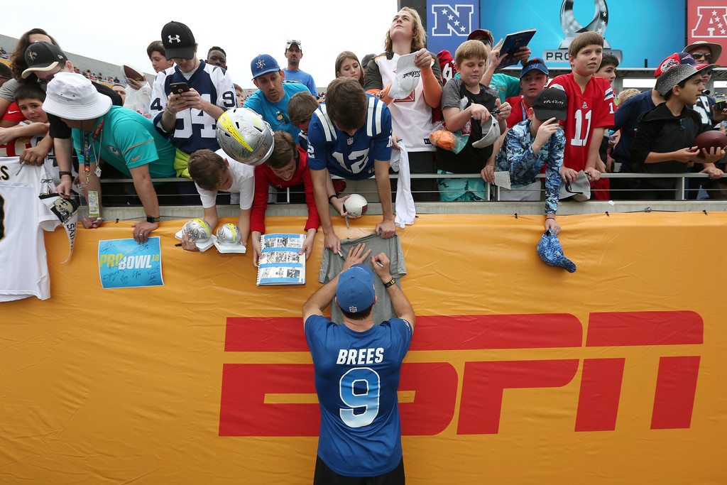 . NFC quarterback Drew Brees, of the New Orleans Saints, signs autographs prior to NFL Pro Bowl football game at Camping World Stadium, Sunday, Jan. 28, 2018, in Orlando, Fla. (AP Photo/Doug Benc)