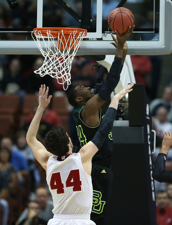 . Cory Jefferson #34 of the Baylor Bears looks to shoot against Frank Kaminsky #44 of the Wisconsin Badgers in the first half during the regional semifinal of the 2014 NCAA Men\'s Basketball Tournament at the Honda Center on March 27, 2014 in Anaheim, California.  (Photo by Jeff Gross/Getty Images)