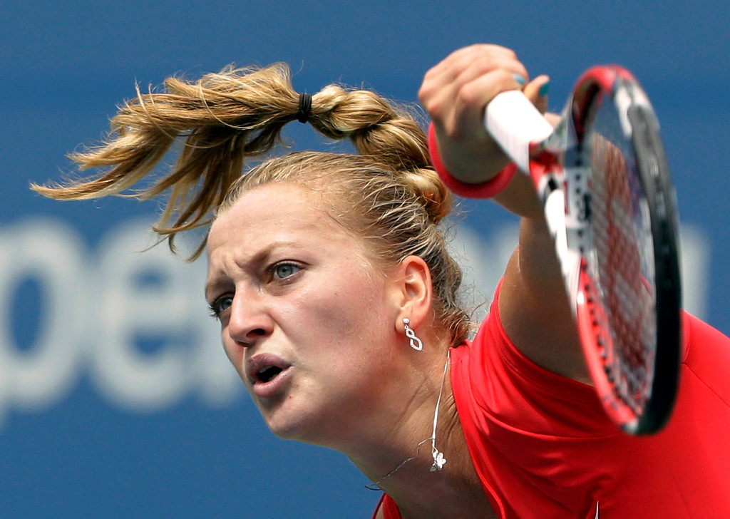 . Petra Kvitova, of the Czech Republic,  returns a shot against Misaki Doi, of Japan, during the first round of the 2013 U.S. Open tennis tournament Tuesday, Aug. 27, 2013, in New York. (AP Photo/Mike Groll)