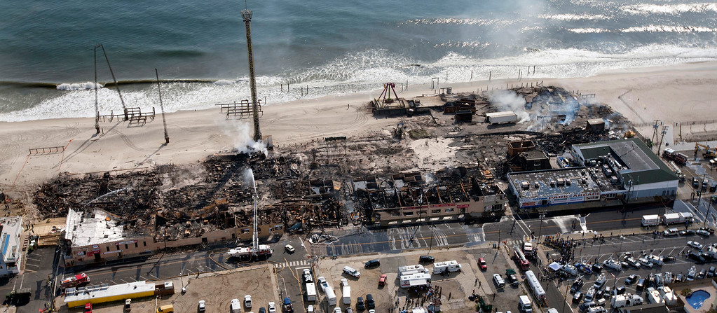 . This aerial photo shows aftermath of a massive fire that burned a large portion of the Seaside Park boardwalk, Friday, Sept. 13, 2013, in Seaside Park, N.J.    (AP Photo/The Asbury Park Press, Bob Bielk)