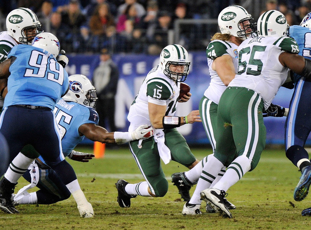 . NASHVILLE, TN - DECEMBER 17:   Quarterback Tim Tebow #15 of the New York Jets is sacked by Zach Brown #55 of the Tennessee Titans at LP Field on December 17, 2012 in Nashville, Tennessee.  (Photo by Frederick Breedon/Getty Images)